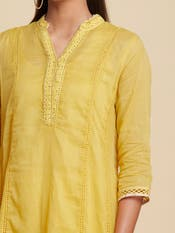 Tisca Chopra in a Mango Yellow Solid Suit Set