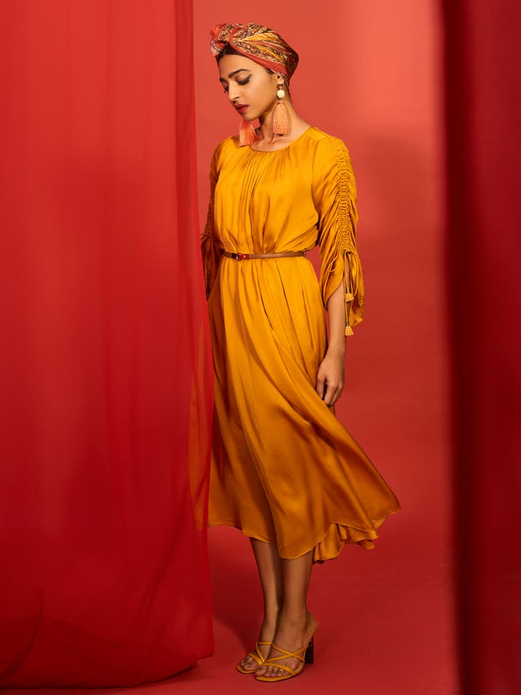 Radhika Apte in a Gold Yellow Dress with Belt